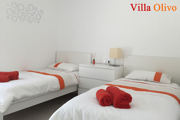 Guest twin bedroom at disabled holiday villa in Spain