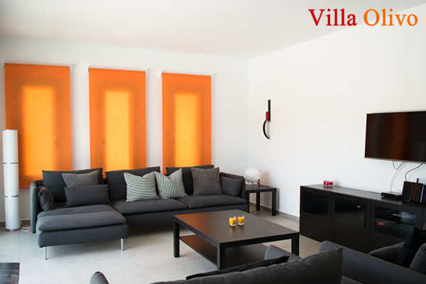 Spacious lounge at accessible holiday villa
