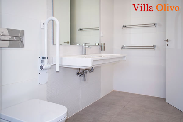 Wheelchair accessible bathroom with roll-in shower in Spanish holiday villa