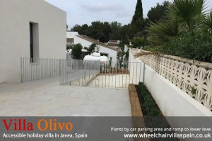 plants-by-private-car-parking-area-and-ramp-to-lower-level-at-acessible-villa-in-spain