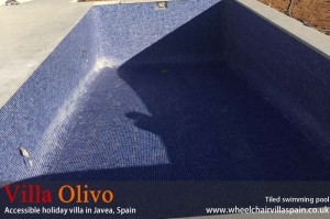 Swimming pool tiling at disabled holiday villa
