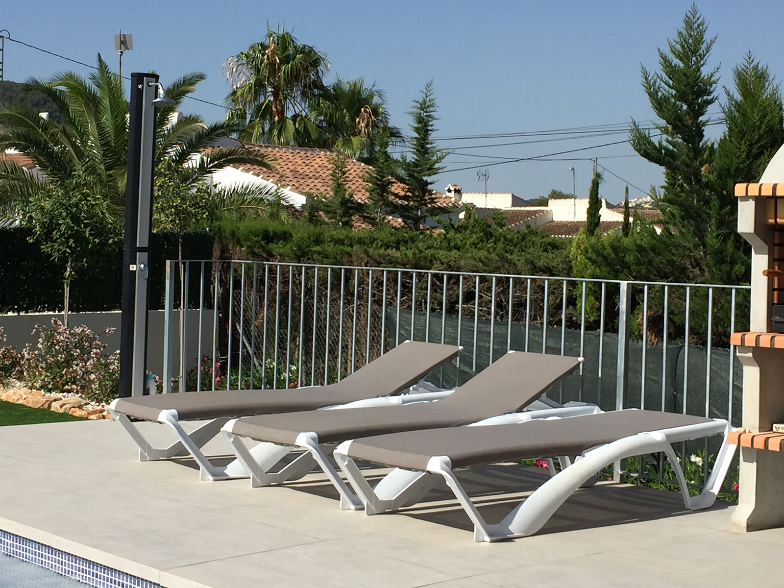 sunloungers-by-swimming-pool-spanish-holiday-villa