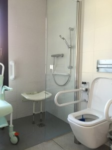 adapted-bathroom-with-shower-chair-and-pull-down-shower-seat